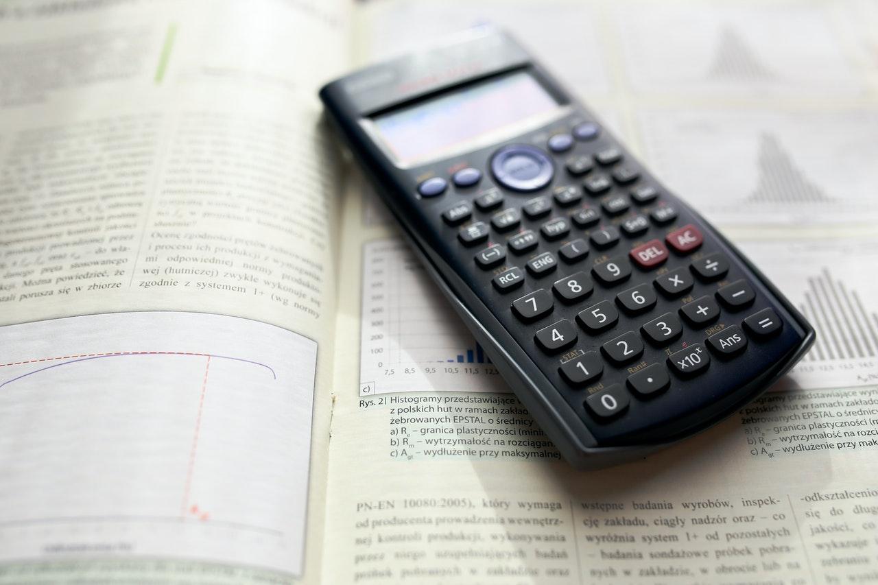 Calculator on a math book